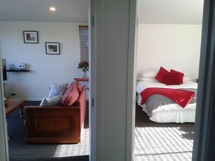 Your bedroom and lounge at Mahurangi West Wing B&B